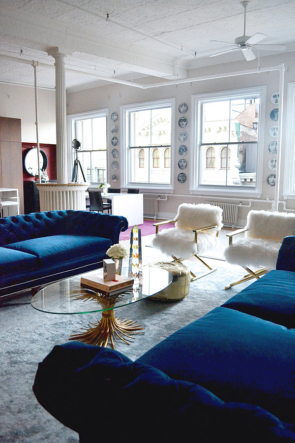 Blue velvet sofas and furry chairs