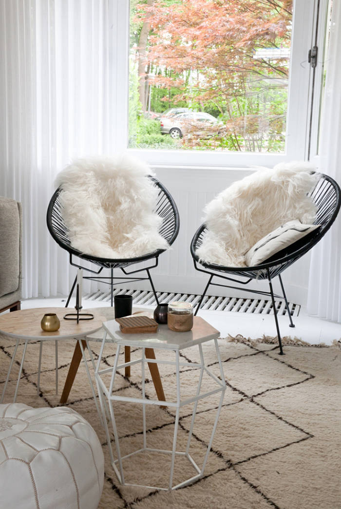 Black acapulco chairs with faux fur
