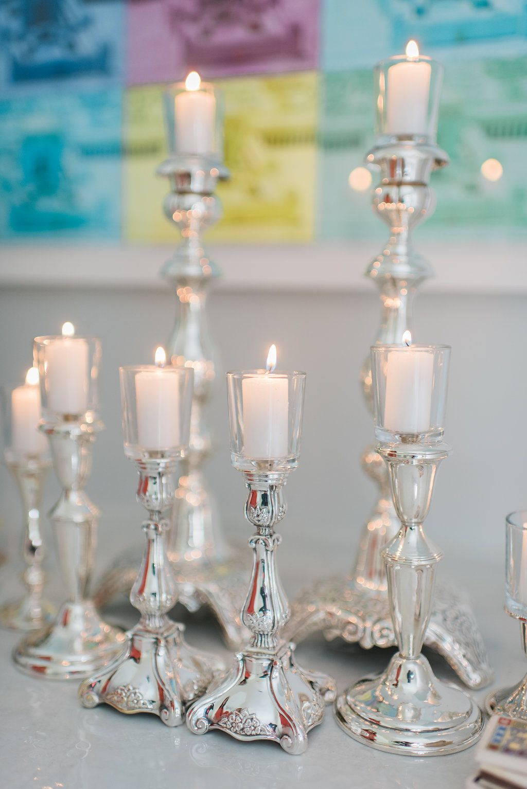 Silver candlesticks with Shabbat candles by Jewish Latin Princess