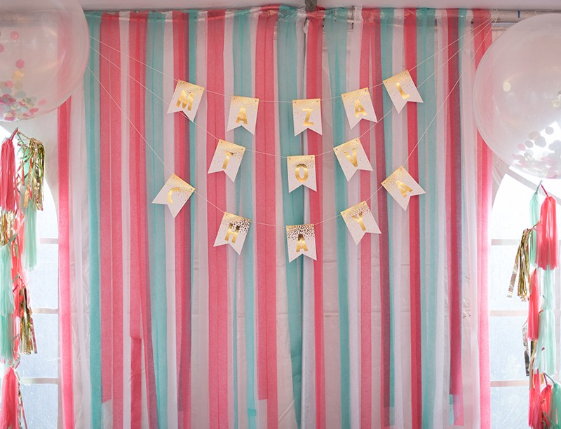Mint and coral streamers backdrop for party