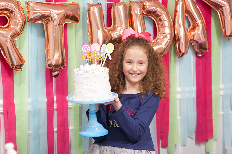 Girl Holding Birthday Cake